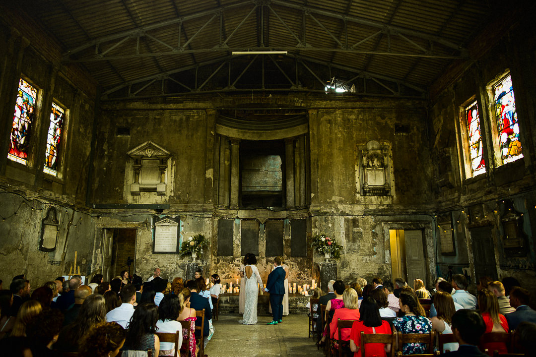 wide shot of same sex wedding at the asylum chapel