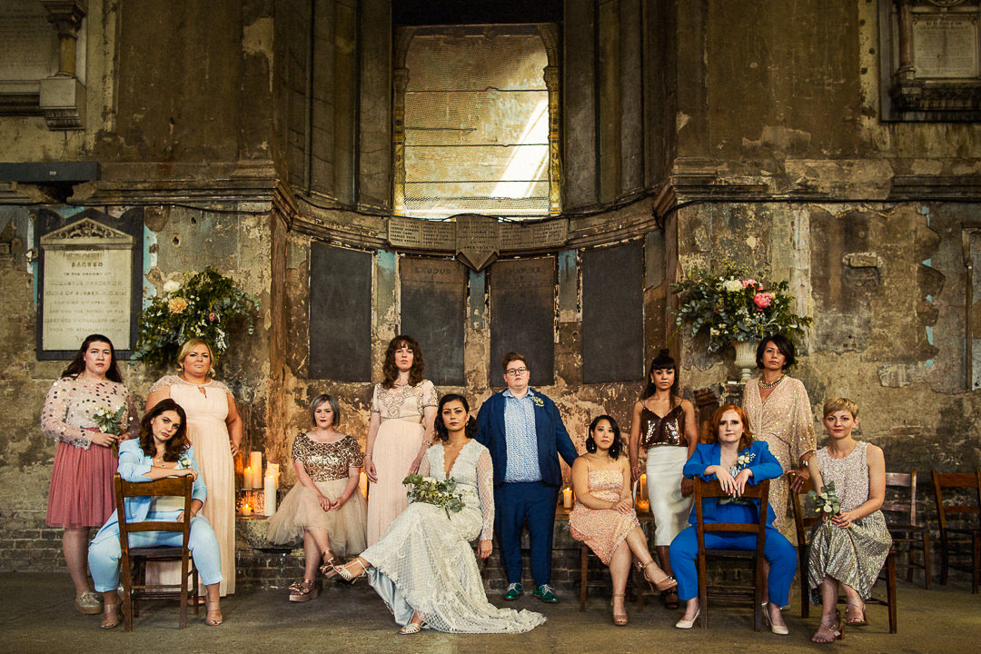A bridal party group shot from a same sex wedding at the asylum chapel in London