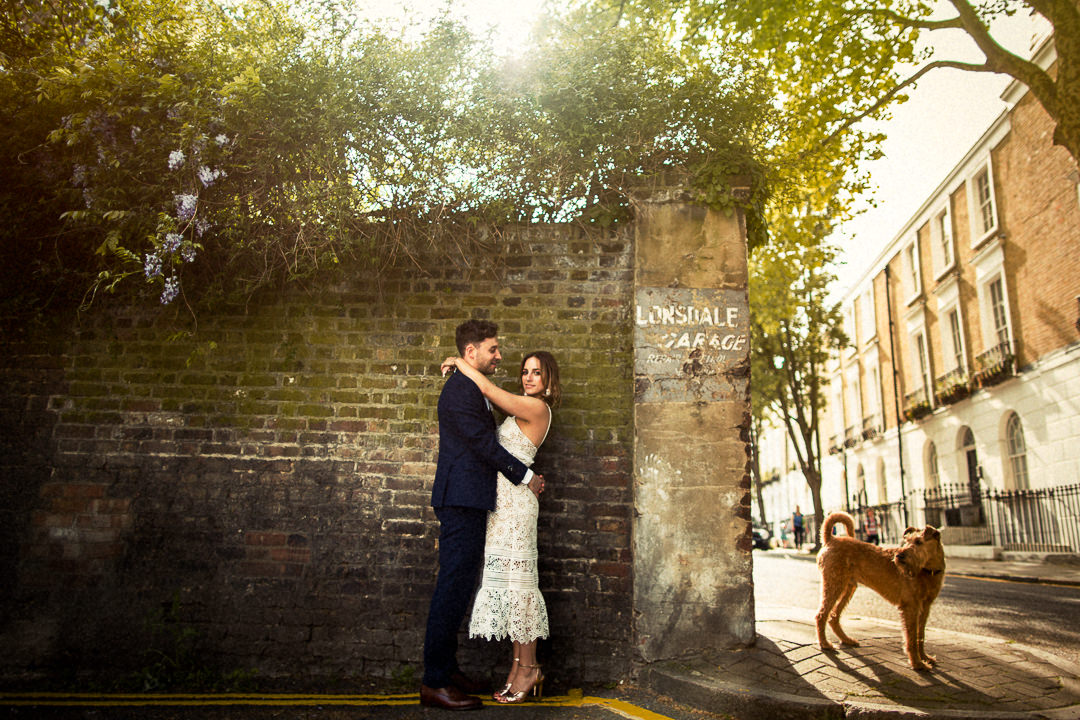 wedding portrait of couple and passing dog