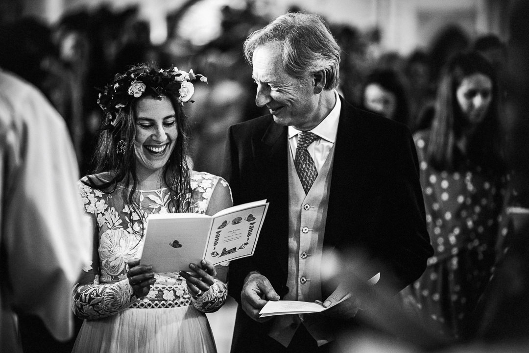bride and her dad share a Joke mid ceremony