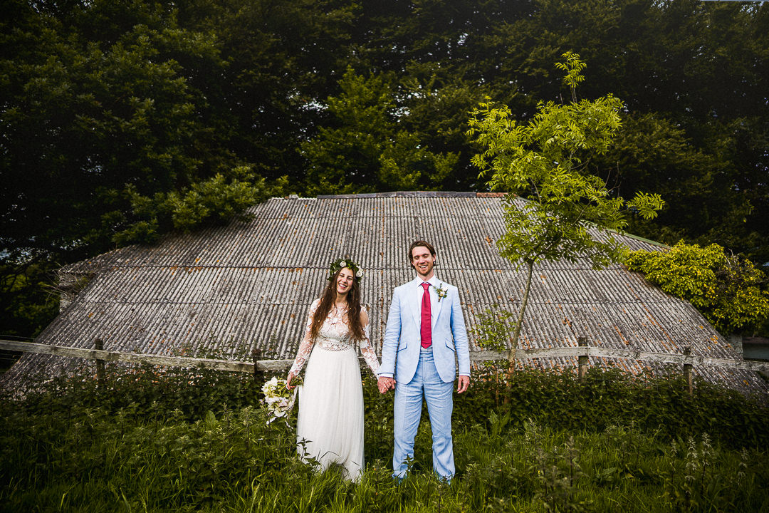 bride and groom portrait outside a disused building
