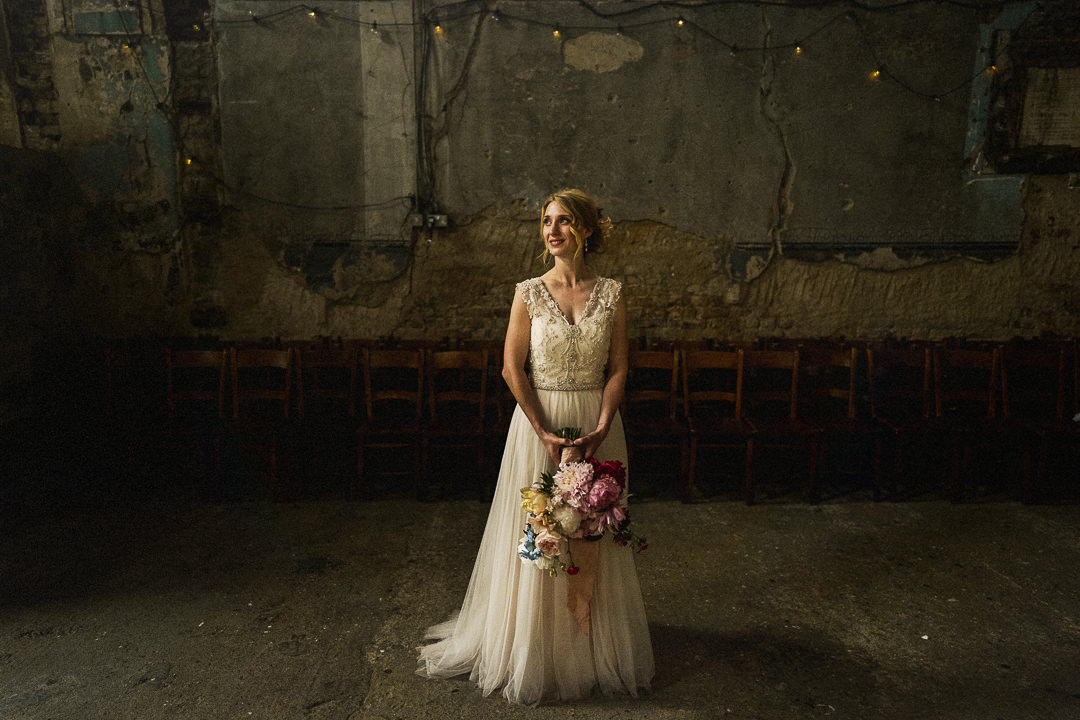 bride with bouquet in natural light