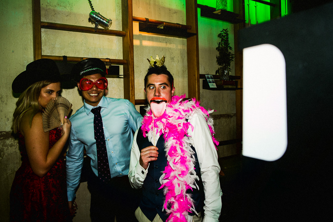 guests suing Photo Booth props at wedding at the tanner warehouse