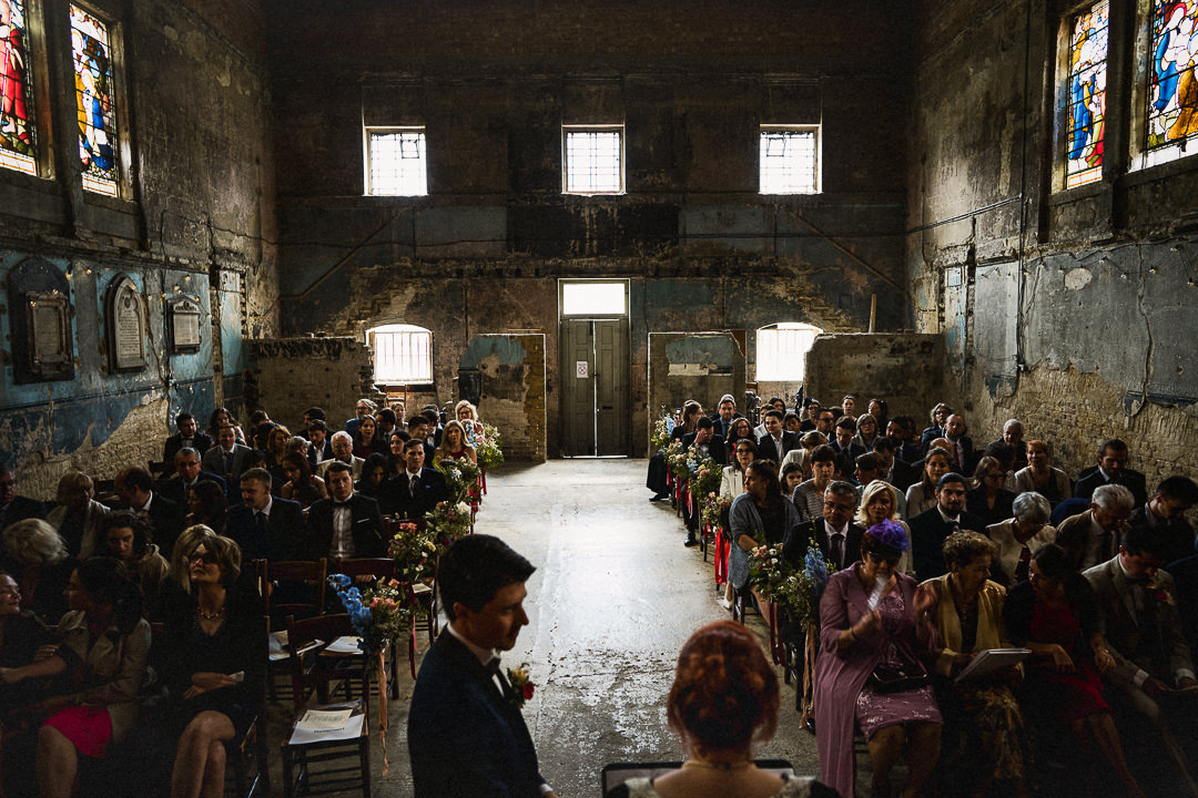 guests seated in the asylum chapel