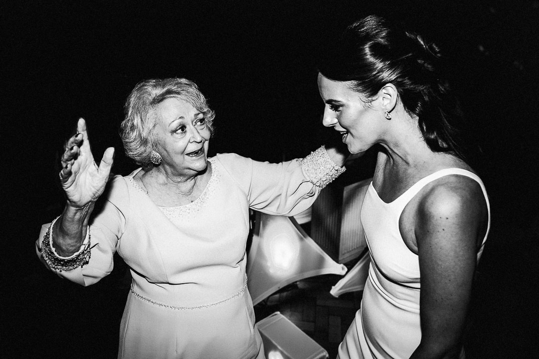 bride dances with her grandmother during wedding