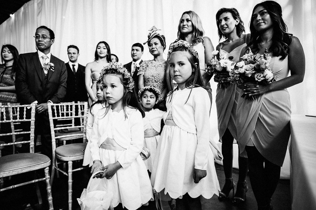 flower girls and bridesmaids during wedding ceremony