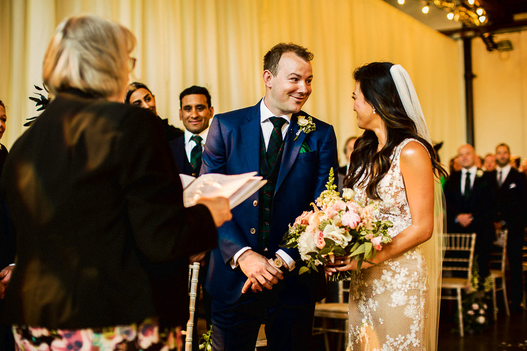 bride and groom see each other for first time during wedding ceremony