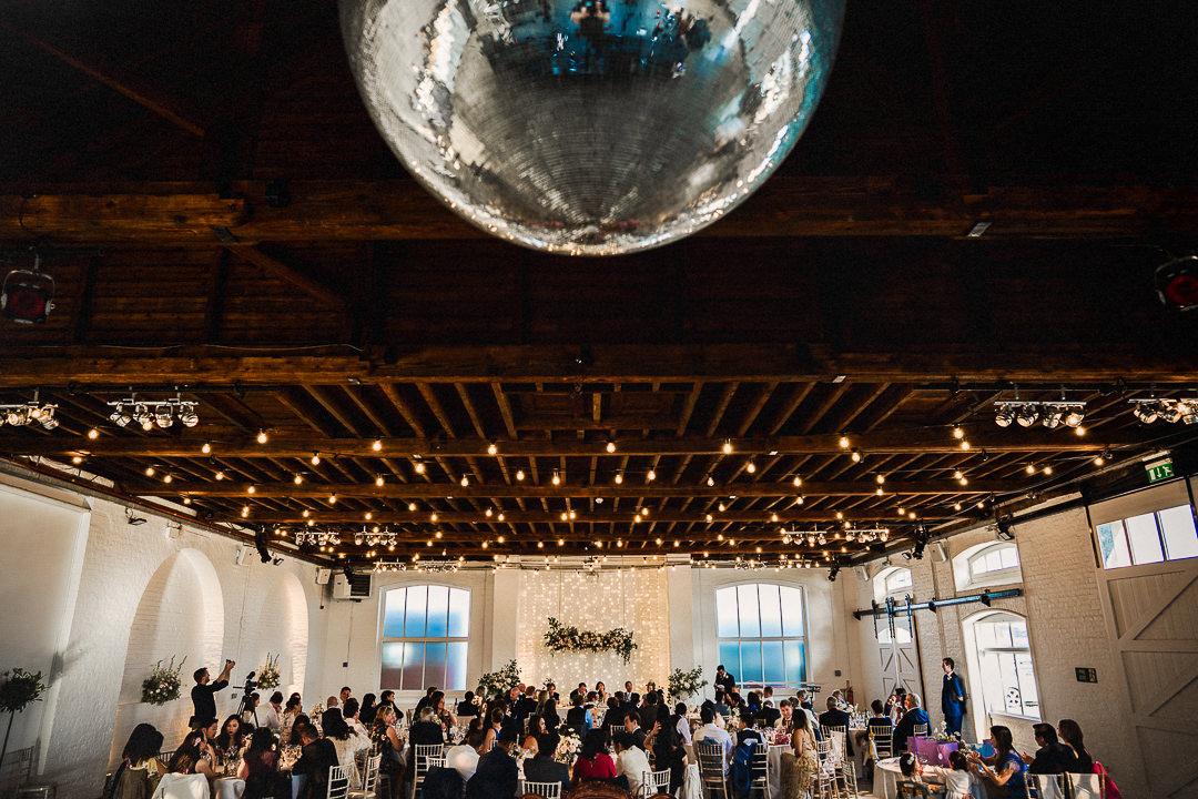 mirror ball hanging above a London wedding venue