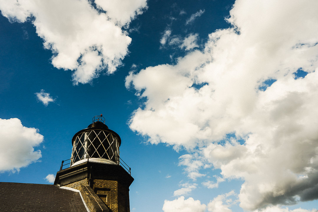 shot of the trinity buoy wharf lighthouse with a blue sky above