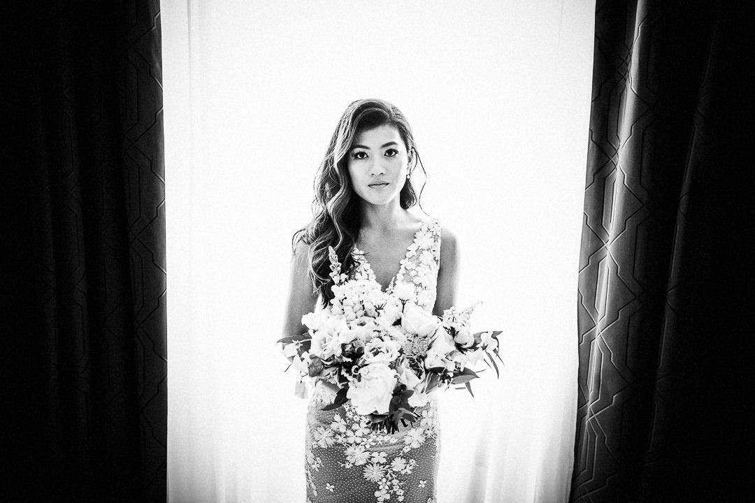 bride in wedding dress holding wedding bouquet