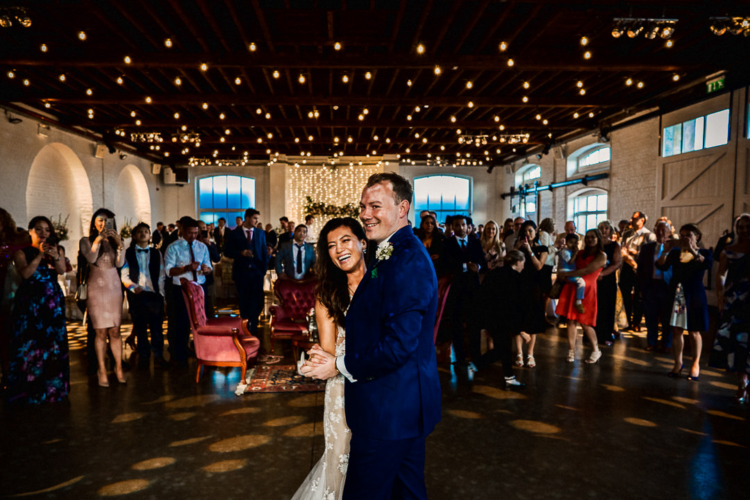 bride and groom and first dance at trinity buoy wharf