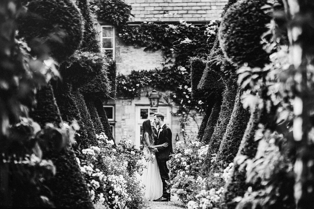 a wedding portrait in the formal rose gardens