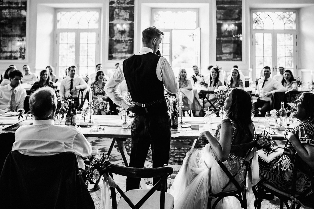 groom delivers his speech in the last orangery ballroom and grotto