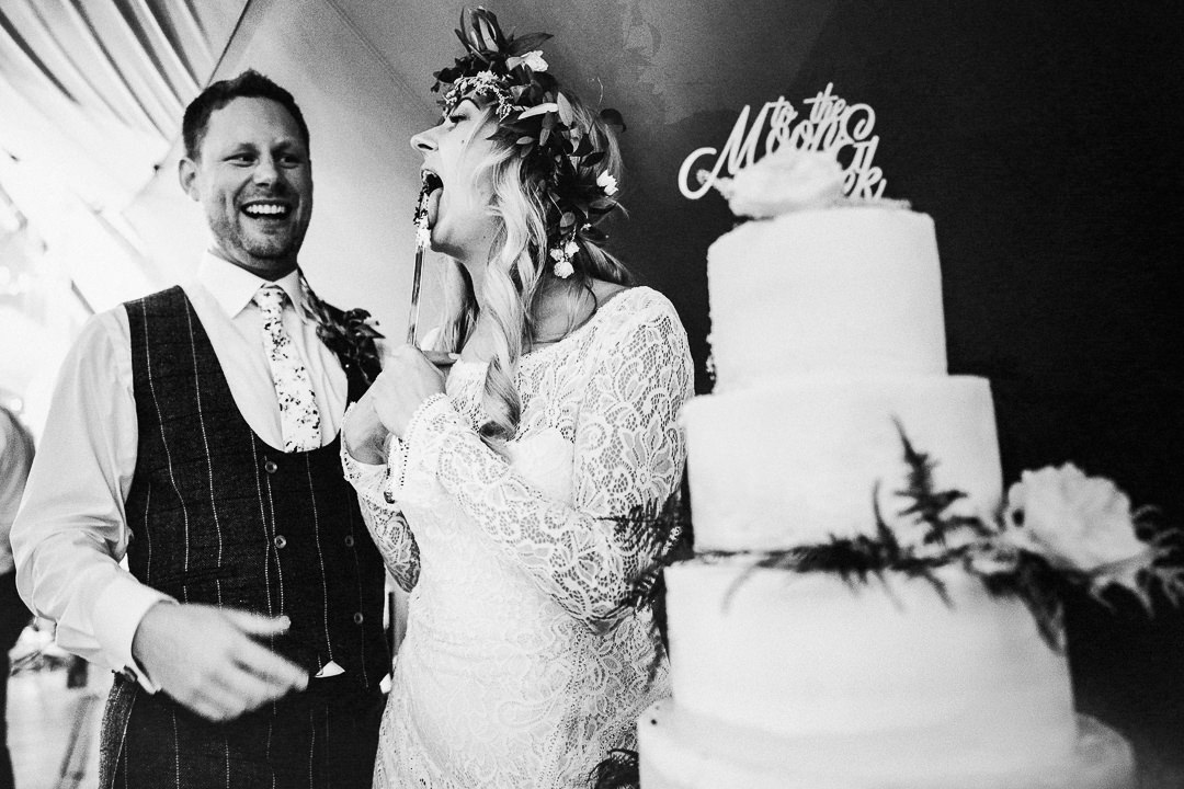 a bride cutting the wedding cake