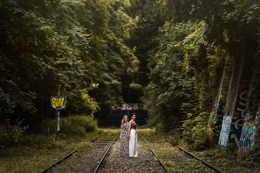 two brides framed by an abandoned railway in Paris