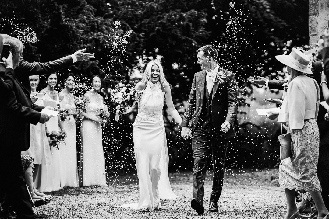 bride and groom exit to confetti