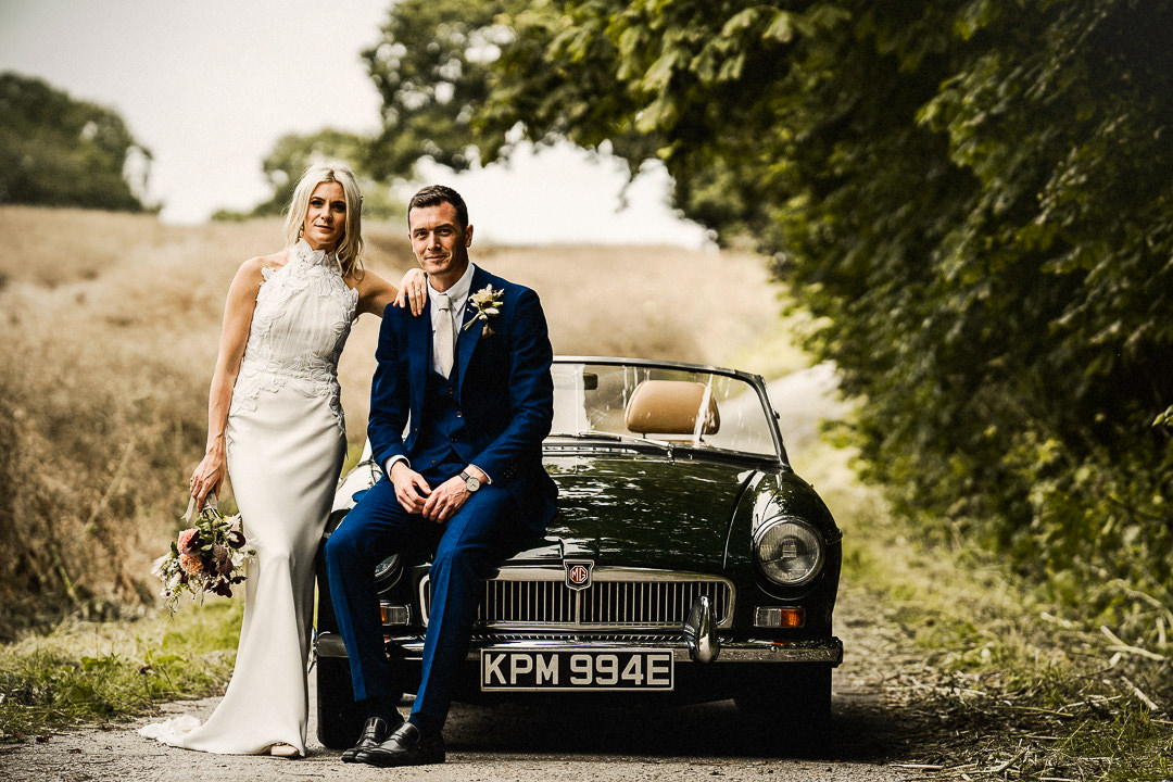 wedding portrait with wedding car