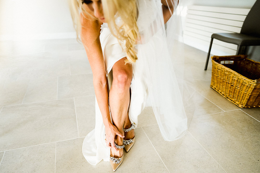 bride puts on her manolo blahnik shoes