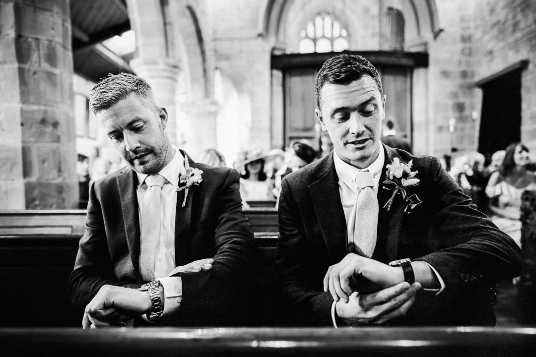 groom and bestman check the time ahead of the wedding ceremony