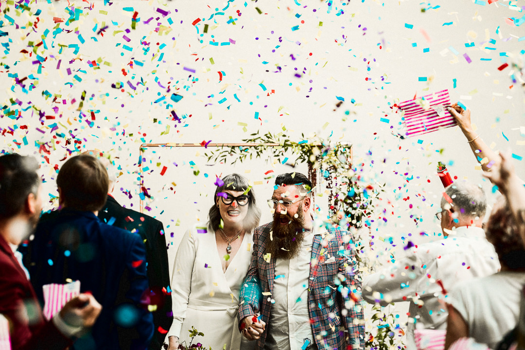 guests cover the couple in confetti after their wedding ceremony at the old dairy hackney