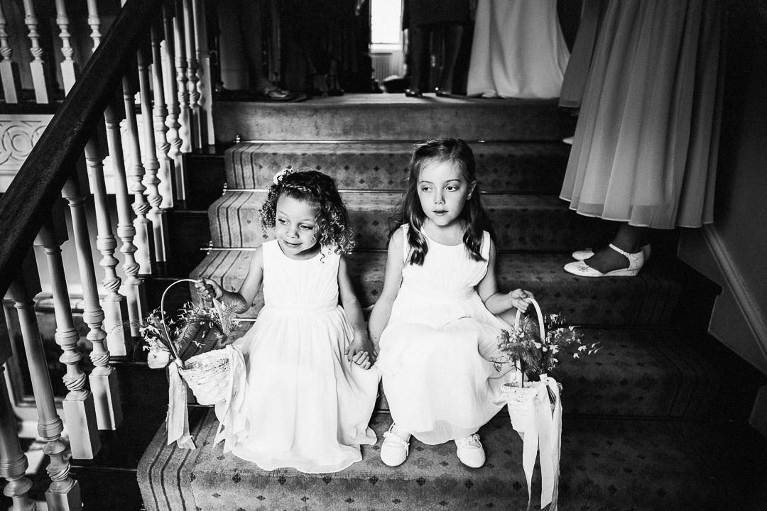 flower girls wait on straircase