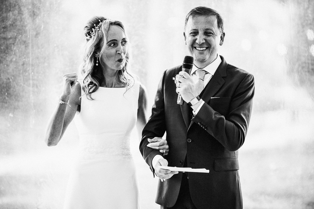 bride jokes with groom during speeches
