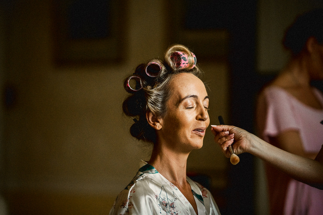 the bride in hair rollers during bridal prep