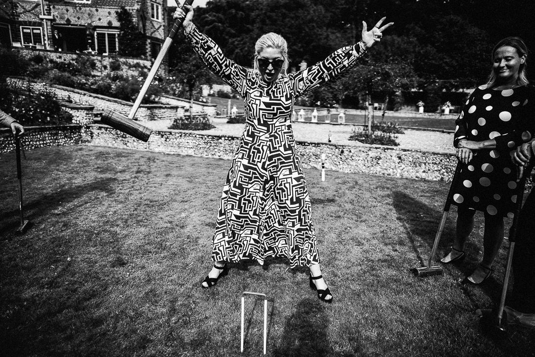 wedding guest celebrating a game of croquet