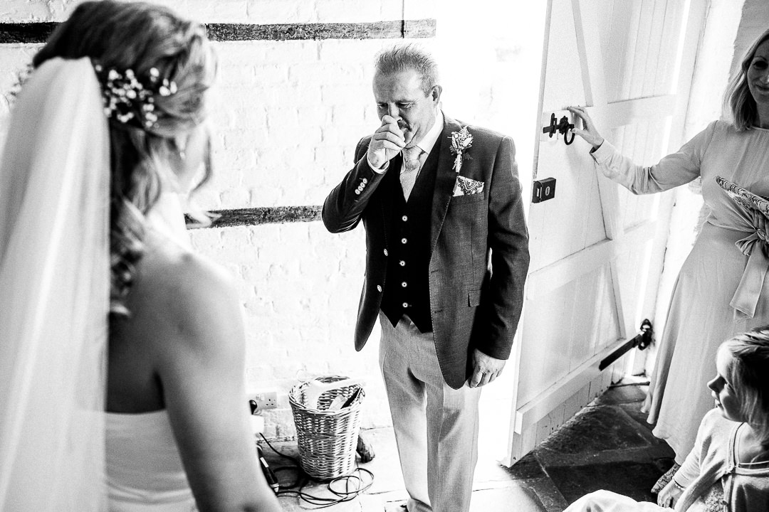 dad reacts emotionally to the bride in her Jesus Peiro dress