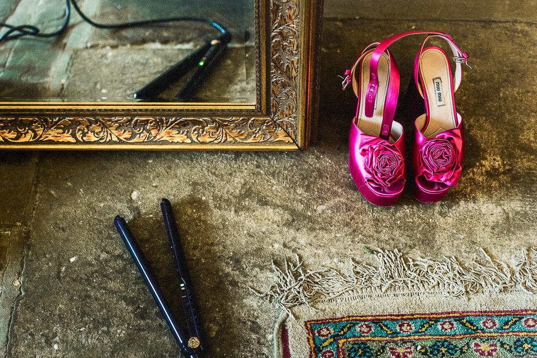 a detail shot of pink shoes at a wedding at lillibrooke manor