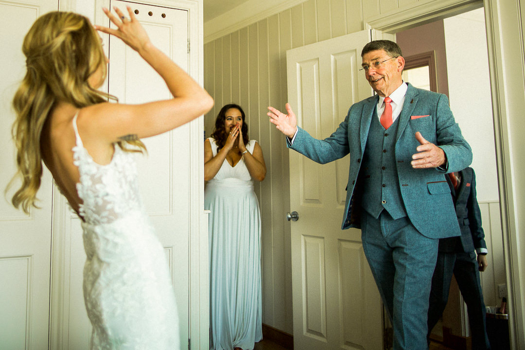 a father of the bride sees his daughter for the first time in her wedding dress at the east quay wedding venue in whitstable