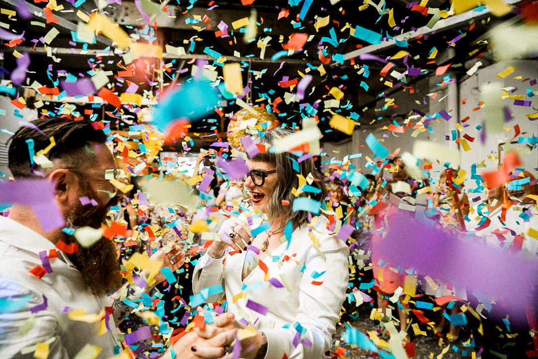 a wedding couple are covered in confetti shot by canons during their first dance at the old dairy in hackney