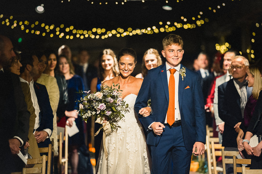 bride walked down the aisle by her son at the electricity shop wedding venue in London
