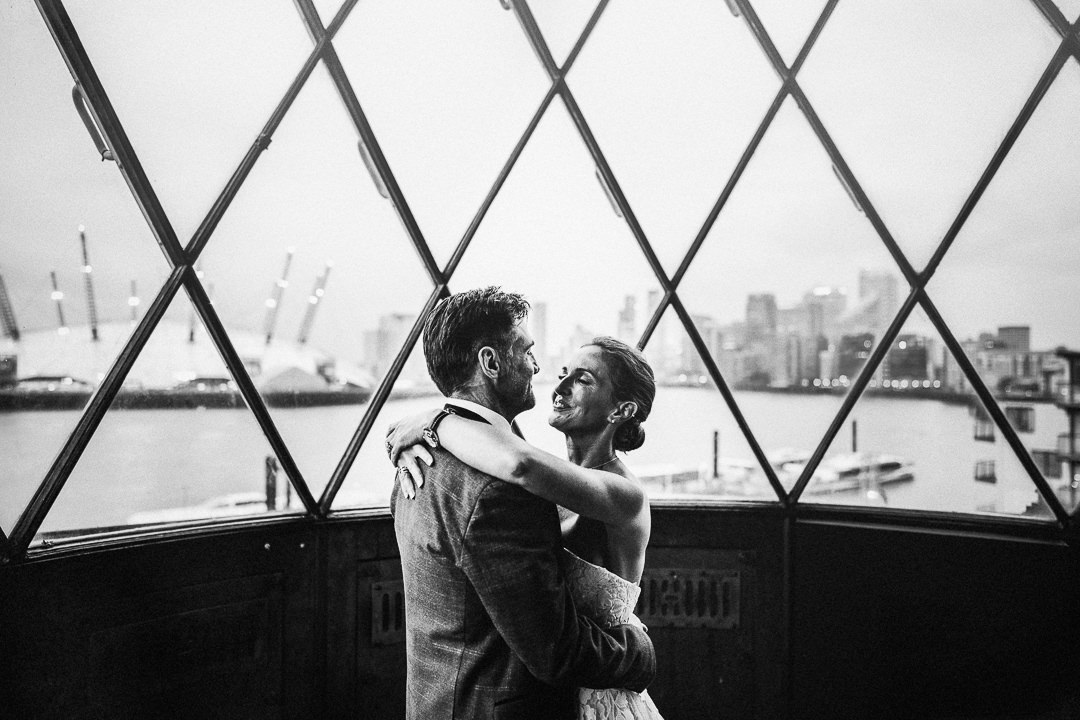 bride and groom portrait at the top of trinity buoy wharfs lighthouse