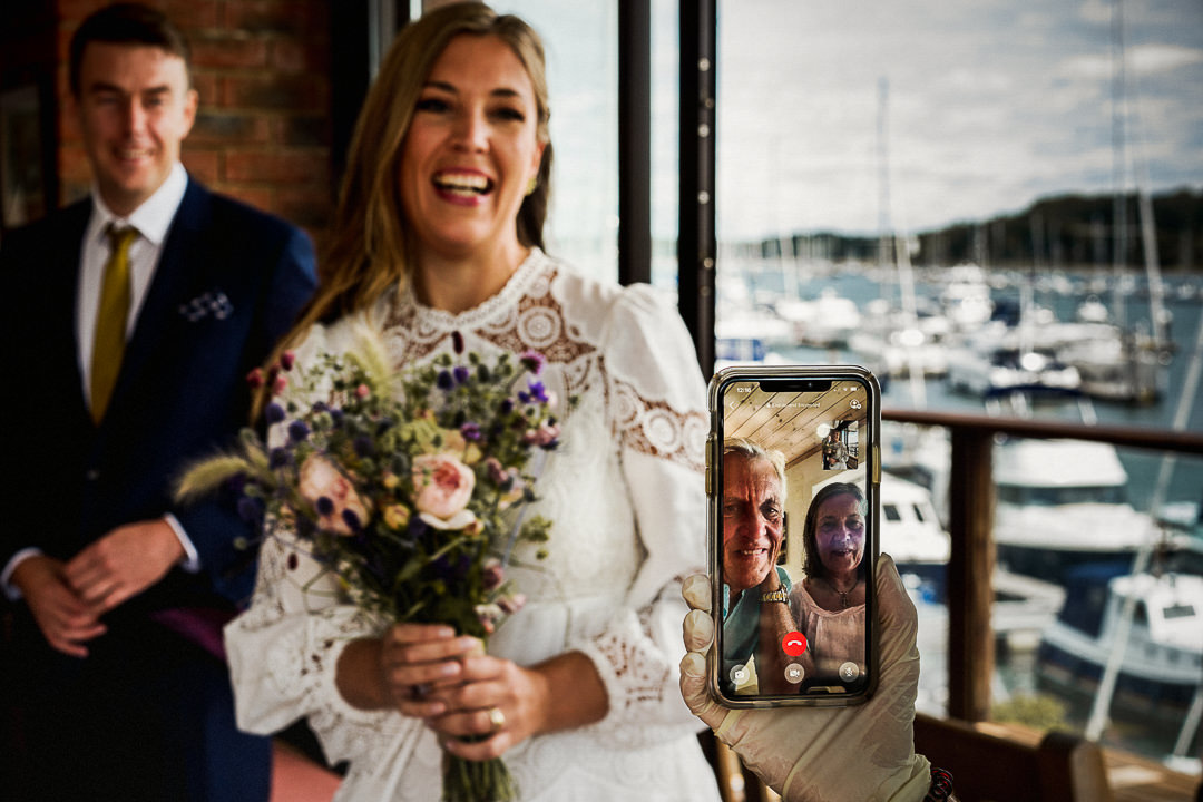 A bride talks to her parents via video link after they watched her wedding ceremony from Sweden