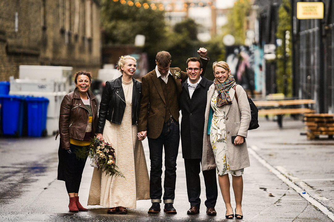 a joyous group shot after a Covid restricted wedding in hackney East London