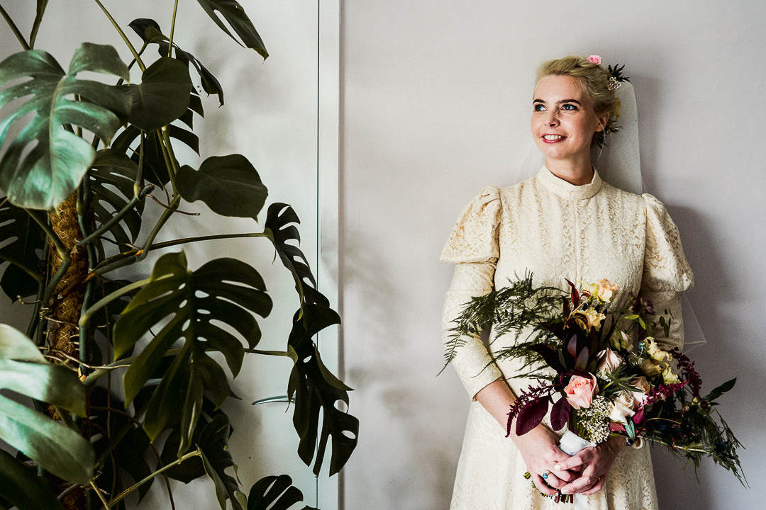 a bride wearing her mums vintage wedding dress