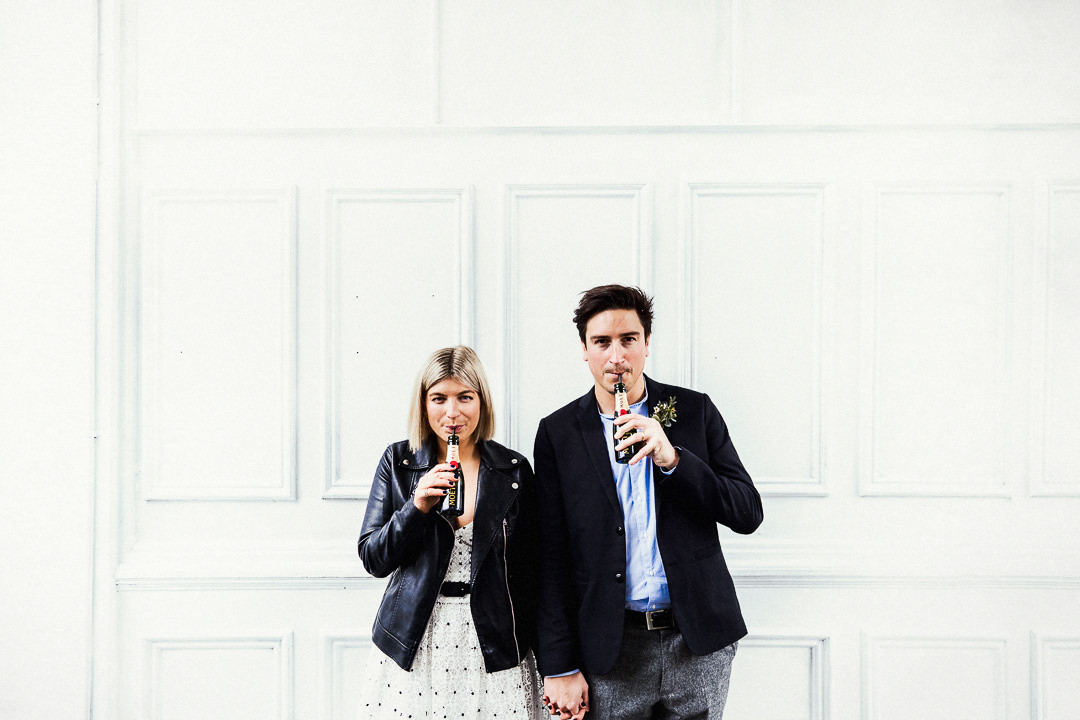 a couple celebrate with champagne after their wedding at Islington Town Hall