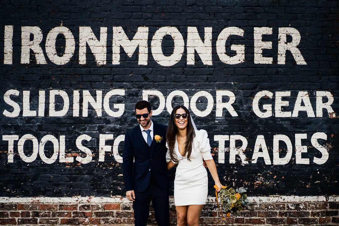 a wedding couple stood in front of a painted wall in the centre of York