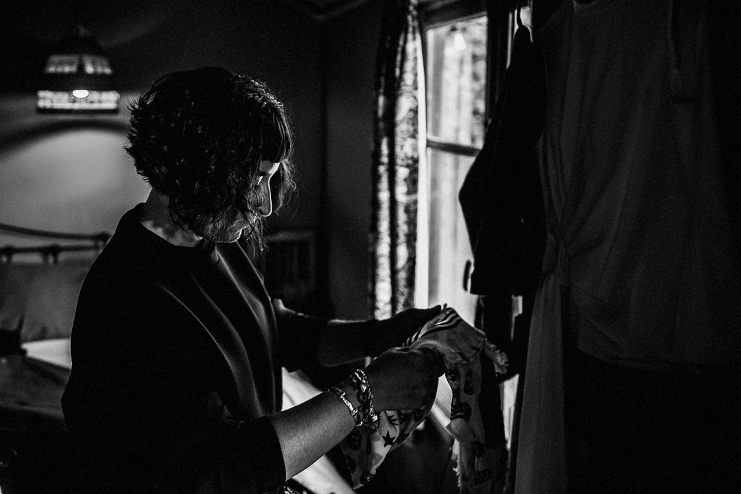a black and white shot of a bride in the shepherd hut at the dreys wedding venue